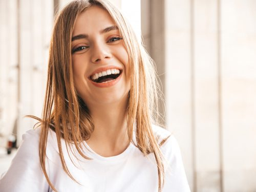 portrait-of-beautiful-smiling-blond-model-dressed-in-summer-hipster-clothes